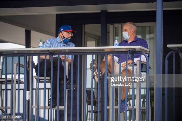 Port St. Lucie, Florida: New York Mets owner Steve Cohen and general manager Sandy Alderson chat during a spring training workout on February 27 in...