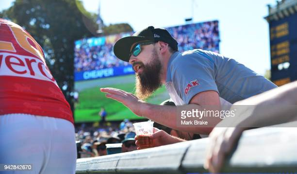 Port supporter gets into the ear of Tom Cutler of the Lions as he kicks for goal during the round three AFL match between the Port Adelaide Power and...