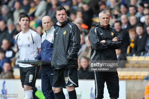 Port Vale Manager Mark Crew and assistant Geoff Horsfield during their match with Bury 26th March 2011.