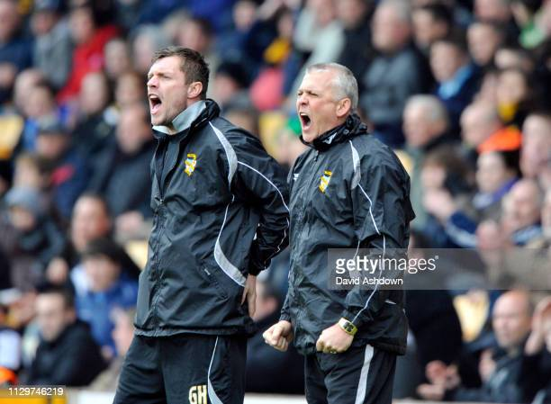 Port Vale Manager Mark Crew and assistant Geoff Horsfield during their match with Bury 26th March 2011