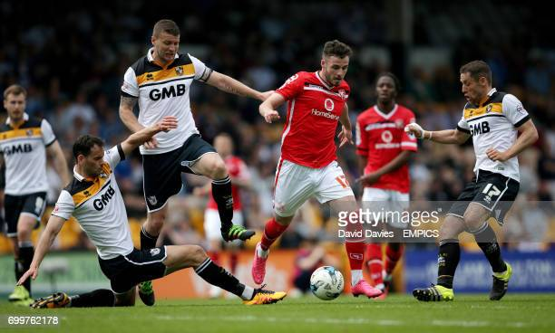 Port Vale's Ben Purkiss and Carl Dickinson battle for the ball with Walsall's Anthony Forde