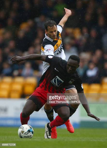 Port Vale's Ben Purkiss and Coventry City's Daniel Agyei battle for the ball