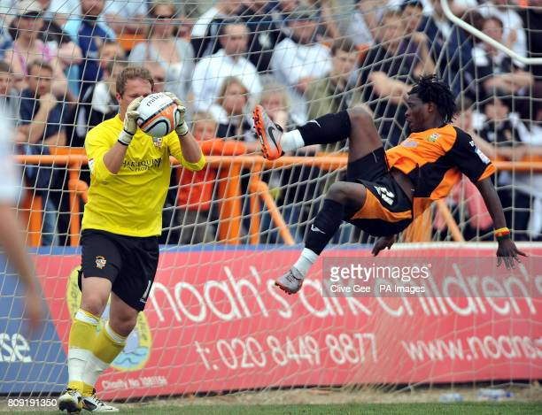 Port Vale's Chris Martin takes the ball before Barnet's Clovis Kamdjo can get a touch during the npower Football League Two match at Underhill...