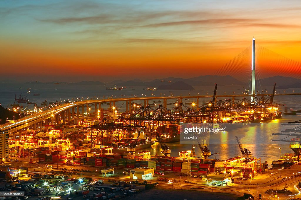 Port warehouse with cargoes and containers : Stock Photo