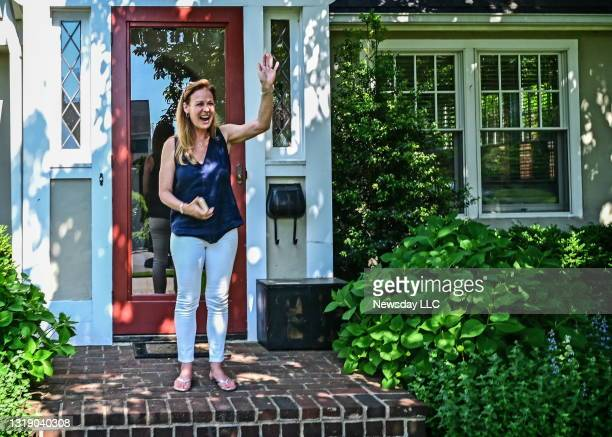 Port Washington, N.Y.: Nanette Melkonian waves to a supporter on the street in front of her Port Washington, New York home on May 19, 2021. Melkonian...