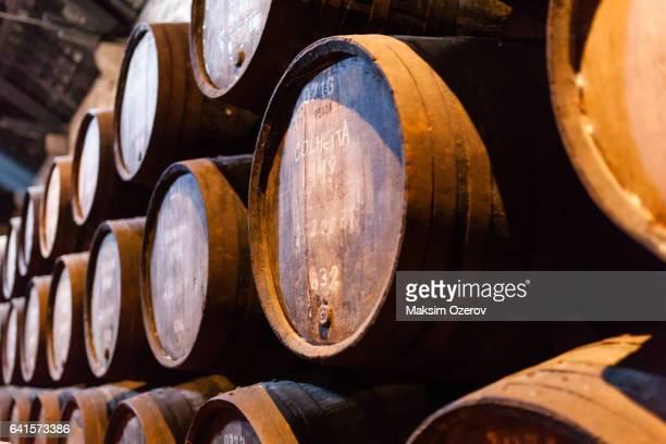 Port wine barrels in warehouse of Calem distillery in Porto