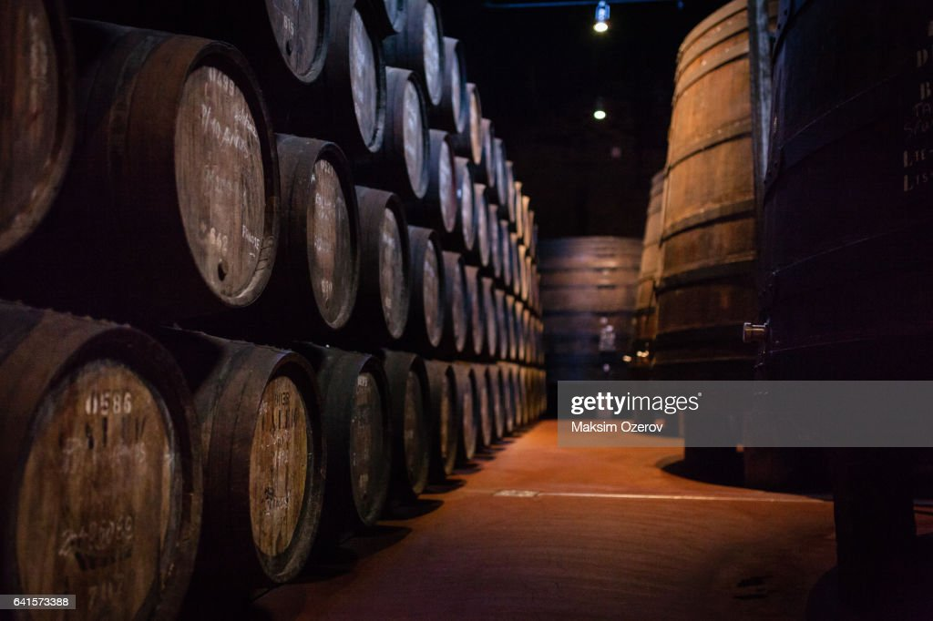 Port wine barrels in warehouse of Calem distillery in Porto : Stock Photo