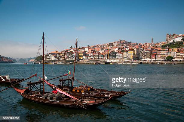 Port wine boats on Douro river with old town view