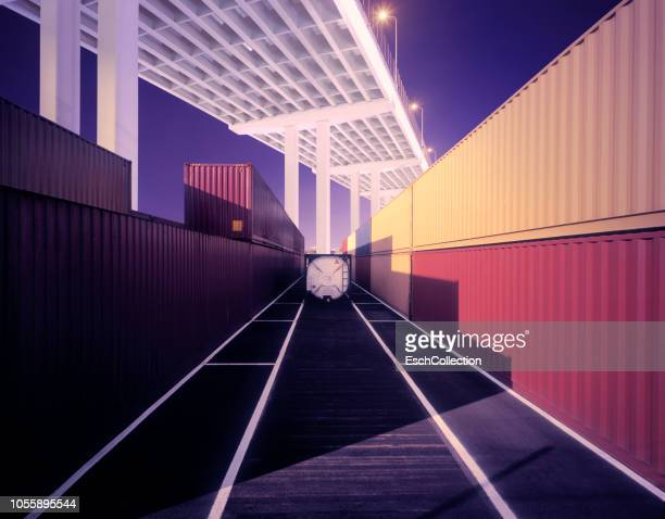 Port with cargo containers neatly stacked at dusk