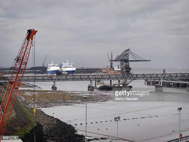 port with cranes and ships - monty rakusen stock-fotos und bilder