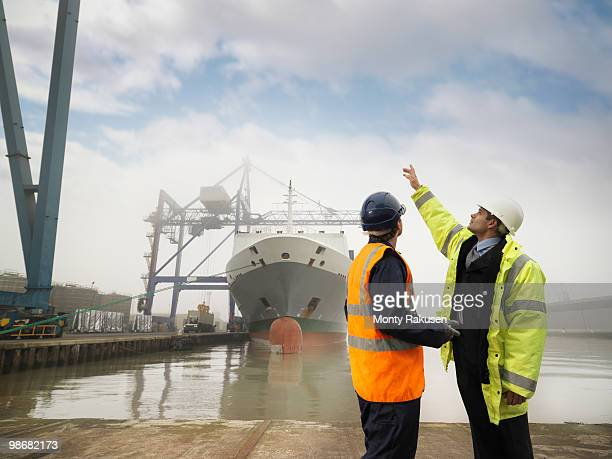 port worker and businessman with ship - dock worker stock photos and pictures