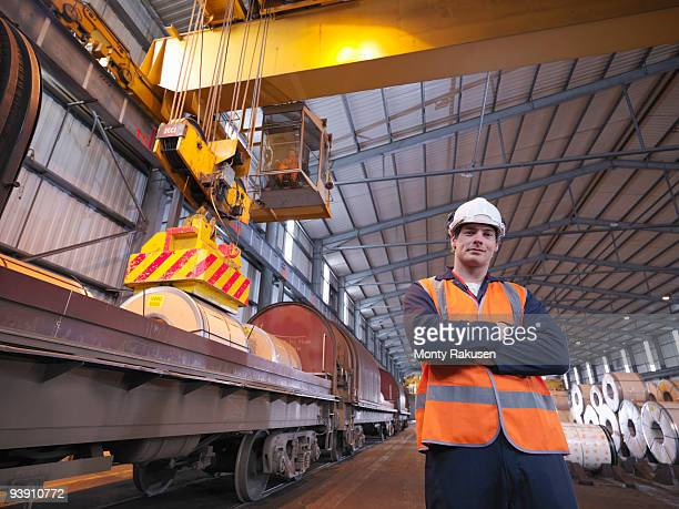 Port Worker In Front Of Train