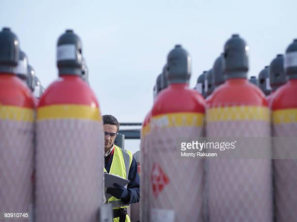 Port Worker With Gas Canisters