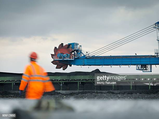 Port Worker With Heavy Machinery