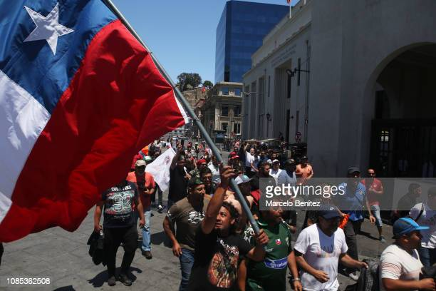 Port workers celebrate the agreement with EPV to end the strike on December 21 2018 in Valparaiso Chile The 35day strike one of the longest in port...