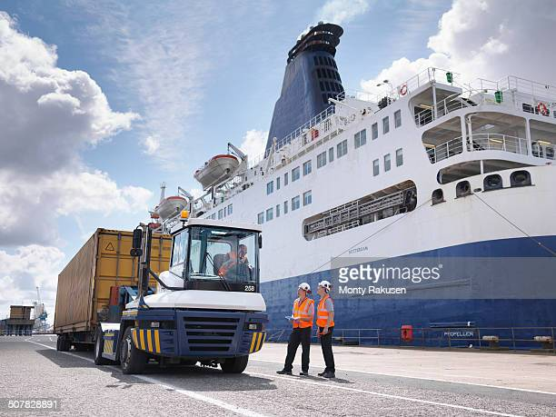 port workers on dock side beside ship - ferry stock photos and pictures