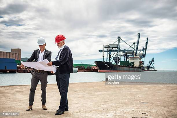 Port Workers With Construction Plans
