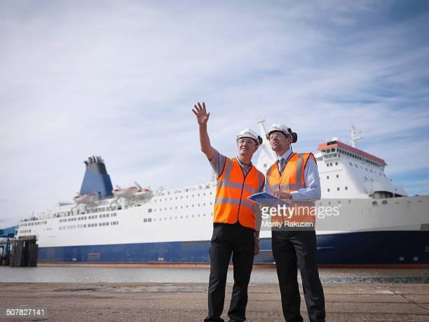 port workers with ship in port - human body part stock-fotos und bilder