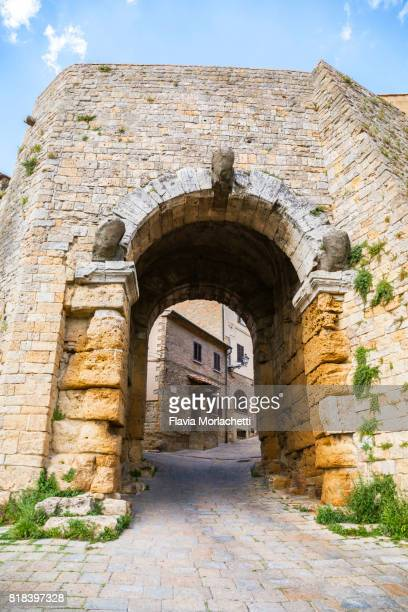 porta all'arco, ancient city door in volterra - volterra stock photos and pictures