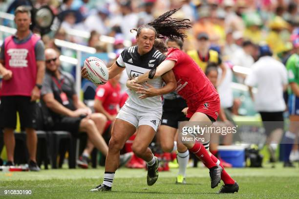 Porta Woodman of New Zealand is tackled in the Cup semi final match against Canada during day two of the 2018 Sydney Sevens at Allianz Stadium on...
