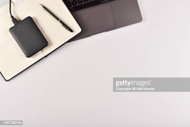 portable external hard disk office desk directly from above - workers compensation stock pictures, royalty-free photos & images