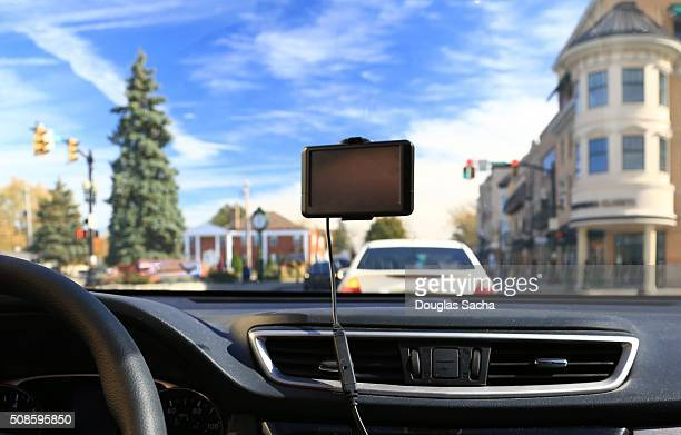 Portable GPS unit hanging on a vehicle windshield