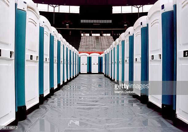 portable restrooms in a stadium - portable toilet stock photos and pictures