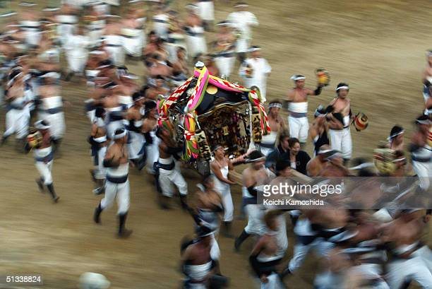 Portable shrines are carried to the playground of a primary school during the Hadaka Festival on September 23 2004 in Ohara Town Chiba Prefecture...