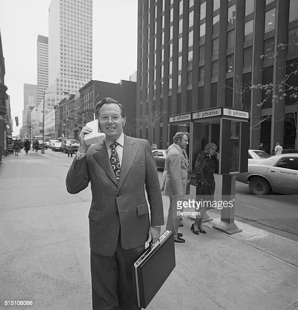 Portable Telephone New York Motorola vice president John F Mitchell shows how easily company's newest productDyna TAC Portable Radio Telephone System...