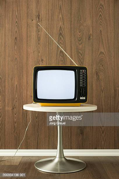 Portable television on table
