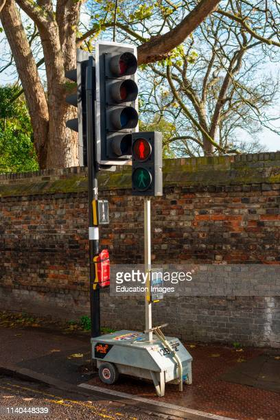 Portable, temporary traffic lights on a street in Cambridge, England, UK.