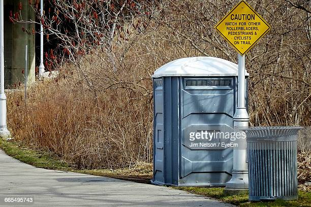 Portable Toilet And Recycle Bin With Signboard At Roadside