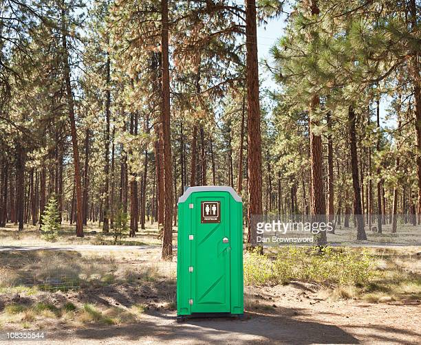 Portable toilet on edge of forest
