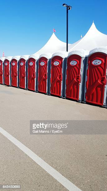 Portable Toilets By Road Against Clear Sky