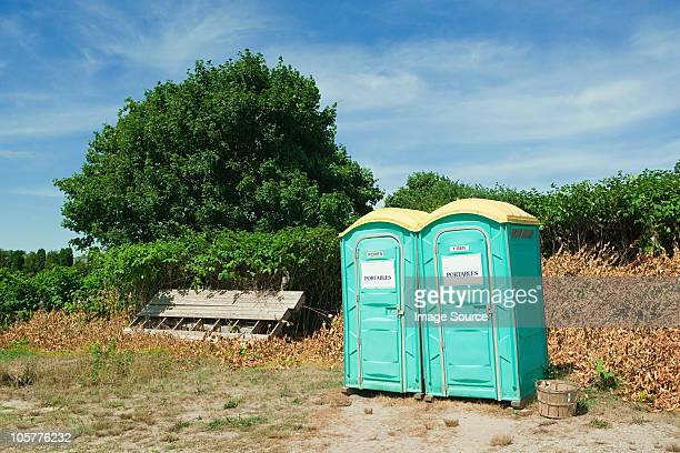 portable toilets in montauk, long island - portable toilet stock photos and pictures