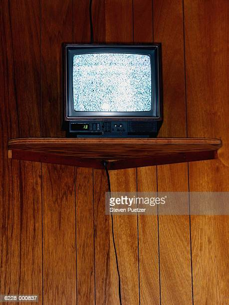 Portable TV and Wood Paneling