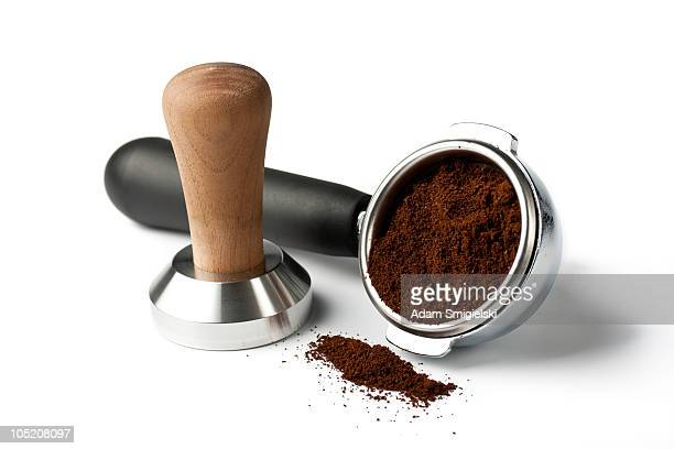 portafilter with tamper and ground coffee