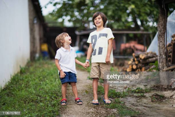 Portait of a 7 year old boy with his little brother