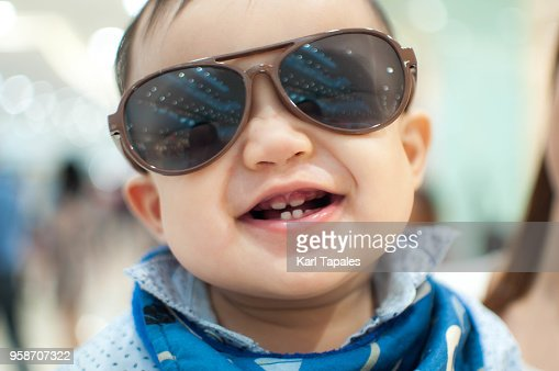 A portait of a baby boy with sunglasses