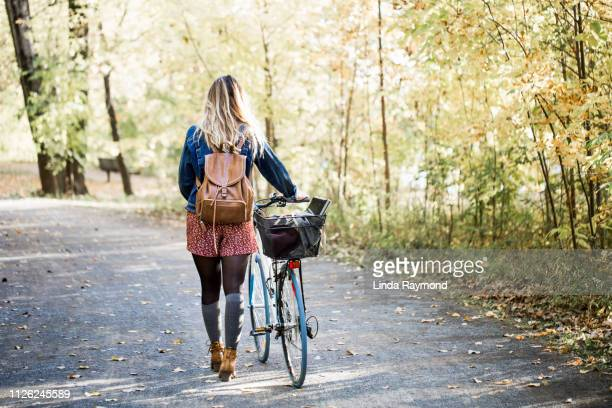 portait of a beautiful young woman during fall season - parkland stock pictures, royalty-free photos & images