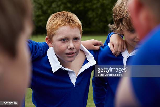 portait of a boy in a group - rugby team stock pictures, royalty-free photos & images