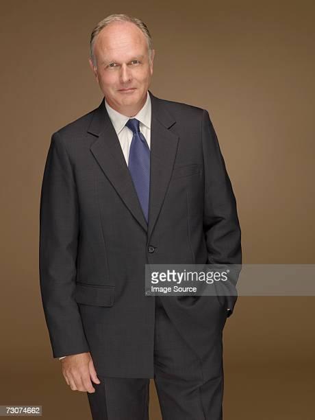 portait of a businessman - mani in tasca foto e immagini stock