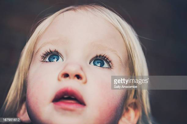 Portait of a little girl looking up