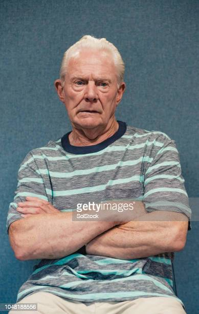portait of a senior man looking anxious - sulking stock pictures, royalty-free photos & images