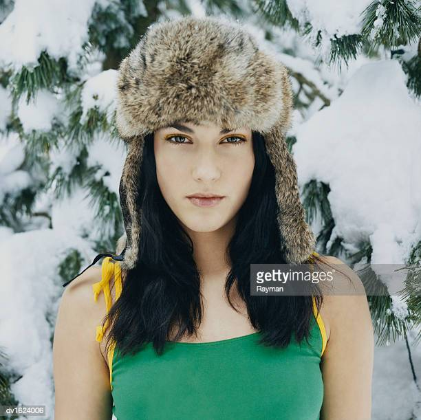 Portait of a Woman Wearing a Fur Hat Outdoors in the Winter