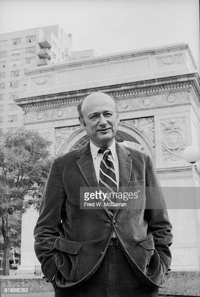 Portait of American politician Ed Koch as he stands hands in his pockets in frontof the arch in Washington Square Park New York New York September 28...
