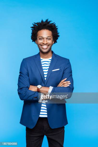 portait of cheerful man - blue jacket stock pictures, royalty-free photos & images