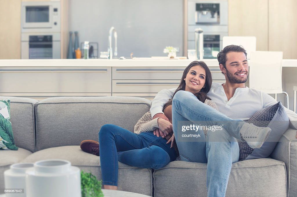 Portait of couple relaxing on the sofa. : Foto de stock