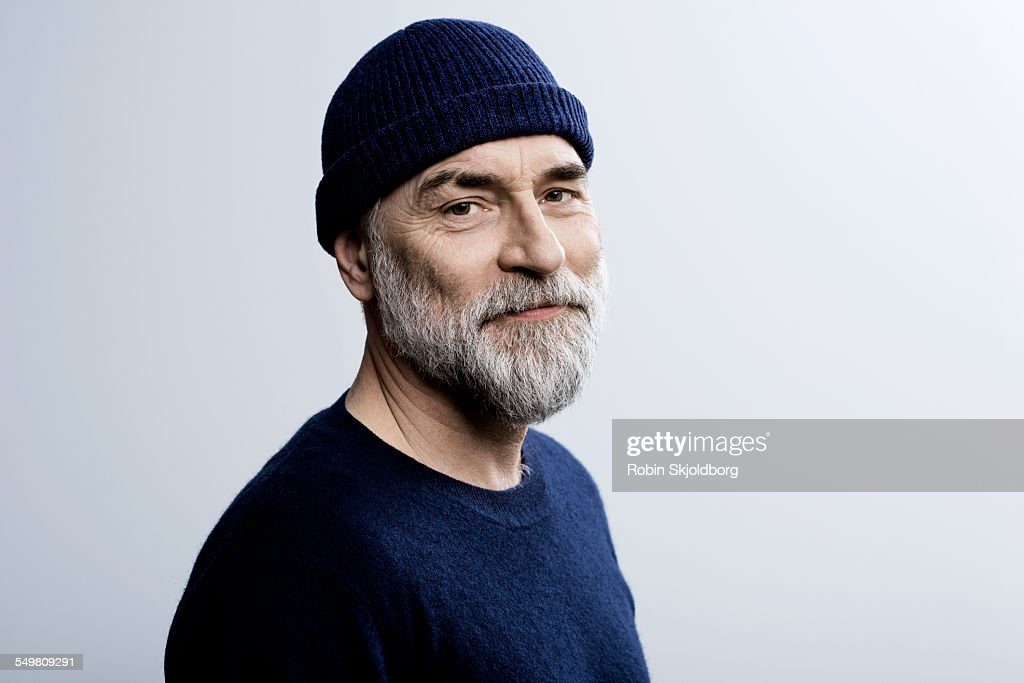 Portait of grey haired man wearing hat : Stock Photo