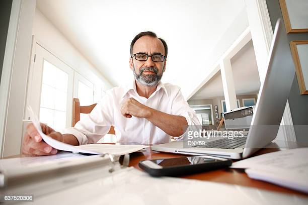 portait of hispanic man working from home - wide angle stock pictures, royalty-free photos & images